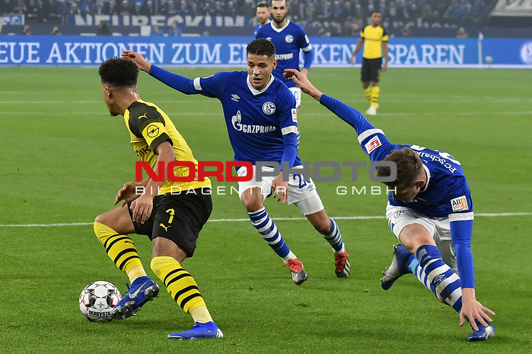 08.12.2018, Veltins-Arena, Gelsenkirchen, GER, 1. FBL, FC Schalke 04 vs. Borussia Dortmund, DFL regulations prohibit any use of photographs as image sequences and/or quasi-video<br /> <br /> im Bild v. li. im Zweikampf Jadon Sancho (#7, Borussia Dortmund) Amine Harit (#25, FC Schalke 04) Bastian Oczipka (#24, FC Schalke 04) <br /> <br /> Foto &copy; nordphoto/Mauelshagen