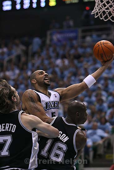Salt Lake City - Utah Jazz forward Carlos Boozer (5) shoots over San Antonio Spurs center Francisco Elson (16), of Netherlands, Utah Jazz vs. San Antonio Spurs, Western Conference Finals game three at EnergySolutions Arena..5.26.2007