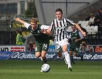 Daviid Wotherspoon (left) and Kenny McLean battle in the St Mirren v Hibernian Clydesdale Bank Scottish Premier League match played at St Mirren Park, Paisley on 18.8.12.