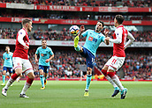 9th September 2017, Emirates Stadium, London, England; EPL Premier League Football, Arsenal versus Bournemouth; Adam Smith of Bournemouth controlling the ball with Mesut Ozil of Arsenal and Aaron Ramsey of Arsenal marking him
