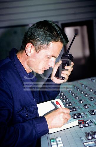 Bosnia and Herzegovina. Termoelektrana - Kakanj/Elektroprivreda BiH; man talking on walkie-talkie in the control room.