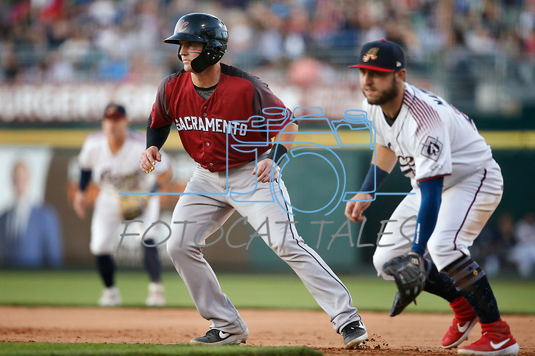 Reno Aces' Wyatt Mathisen holds Sacramento River Cats baserunner on during a game in Reno, Nev., on Thursday, July 4, 2019.<br /> Photo by Cathleen Allison/Nevada Momentum