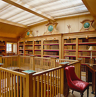 The bookshelves in the gallery library are made of sturdy oak panelling with pietra dura inlays