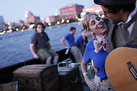 NEW YORK - AUG 30: The cast and crew of The Confidence Man perform a dress rehearsal aboard The Lilac, an old Coast Guard Steamship, docked at Pier 40 on the Hudson River in Lower Manhattan on Sunday, August 30, 2009. (Photo by Landon Nordeman)