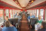 Essex, CT Steam Train excursion. Railcar interior with passengers.