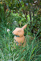 Small bunny figure in the meadow (chives) at Tammi Hartung garden