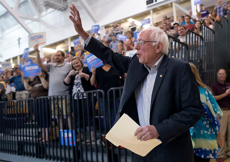"UNITED STATES - August 16: Sen. Bernie Sanders, D-Vt., is greeted by a standing ovation before he speaks at the Loras College Athletic and Wellness Center in Dubuque, Iowa, on Sunday, August 16, 2015. The ""town meeting,"" was the fourth campaign event of the day for Sanders. (Photo By Al Drago/CQ Roll Call)"