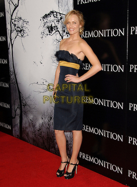"AMBER VALETTA.attends World Premiere of Tri Star Pictures' ""Premonition"" held at The Arclight Theatre in Hollywood, California, USA, March 12 2007..full length strapless black ruffle dress yellow band stripe hand on hip gold platform shoes Valetta Valeta Valletta.CAP/DVS.©Debbie VanStory/Capital Pictures"