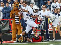 College Park, MD - November 25, 2017: Penn State Nittany Lions running back Saquon Barkley (26) gets pushed out of bounds during game between Penn St and Maryland at  Capital One Field at Maryland Stadium in College Park, MD.  (Photo by Elliott Brown/Media Images International)