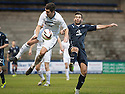 Raith Rovers' Liam Fox and Dundee's Peter MacDonald challenge for the ball.