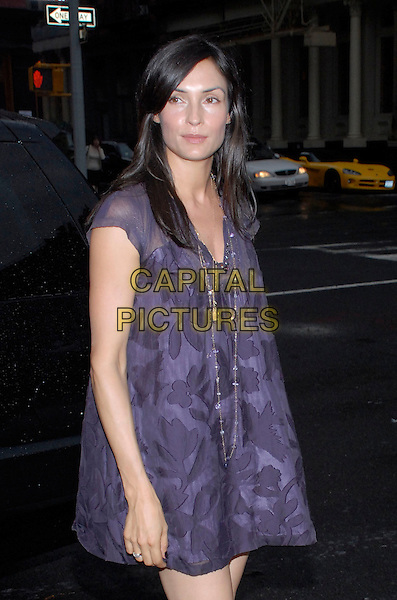 "FAMKE JANSSEN.The Cinema Society and Dior Beauty present a screening of Sony Picture Clasics' ""Interview"" at the Tribeca Grand Hotel Screening Room, New York City, New York, USA,.11 July 2007..half length black and purple print tunic dress necklace.CAP/ADM/BL.©Bill Lyons/AdMedia/Capital Pictures. *** Local Caption ***"