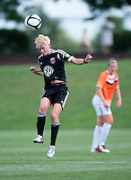 Joanna Lohman (17) of the D.C. United Women heads the ball during the game at the Maryland SoccerPlex in Boyds, Maryland.  The D.C. United Women defeated the Charlotte Lady Eagles, 3-0, to win the W-League Eastern Conference Championship.