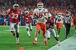 Clemson Tigers quarterback Trevor Lawrence (16) scrambles down field for a touchdown during the Fiesta Bowl game against the Ohio State Buckeyes on Saturday, Dec 28, 2019 in Glendale, Ariz.  (Gene Lower via AP)