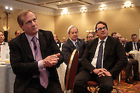 September 26 2012 - Montreal Quebec CANADA - Louis Audet, President & CEO of COGECO et Cogeco Cable,discuss with Pierre-Karl Peladeau, CEO QUEBECOR after speaking at the Canadian Club of Montreal's podium.<br /> <br /> What is Cogeco? A cable distributor? A broadcaster? No one can claim to truly know this major telecommunications industry player better than its President and CEO, Louis Audet. Under his guidance, Cogeco Cable has become the second-largest cable distribution company in Québec and Ontario, serving nearly 900,000 subscribers from Gaspé to Windsor. Cogeco Cable, through Cogeco Data Services, operates data centres for its business customers in both provinces. Today, Cogeco Diffusion, a COGECO Inc. affiliate company, is a leading Quebec radio broadcaster with 13 stations and provides news services to 47 radio stations across the province. Through Cogeco Métromédia, the company also offers specialized media representation services in the public transit signage sector in major Québec and Canadian cities. In addition, within a very few months Cogeco Cable will expand its cable distribution operations to the United States following its recent acquisition of Atlantic Broadband.