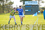 Cillian Young on a run up the sideline being closely followed by Lispole's Mathew Griffin.