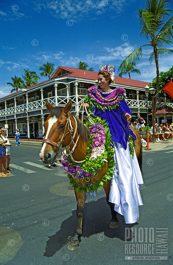 A rider in the annual King Kamehameha Day parade passes the Pioneer Inn on Front Street, Lahaina.