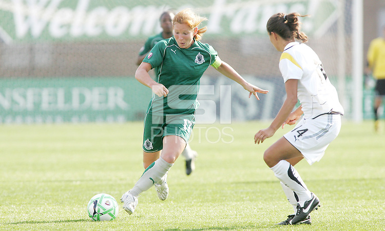 Lori Chalupny (green) takes on Stphanie Cox...Saint Louis Athletica and LA Sol, played to a 0-0 tie at Robert Hermann Stadium in St Louis, MO. April 25 2009.