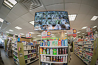 A monitor shows the video feeds of security cameras of a drug store in New York on Monday, March 23, 2015. (©  Richard B. Levine)