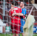 Stranraer keeper David Mitchell is congratulated after he saves Pars' Ryan Wallace's penalty.