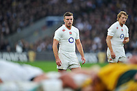 George Ford of England watches a scrum. QBE International match between England and Australia on November 29, 2014 at Twickenham Stadium in London, England. Photo by: Patrick Khachfe / Onside Images