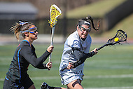Towson, MD - March 5, 2017: Towson Tigers Michelle Gildea (24) gets pass a Florida Gators defender during game between Towson and Florida at  Minnegan Field at Johnny Unitas Stadium  in Towson, MD. March 5, 2017.  (Photo by Elliott Brown/Media Images International)