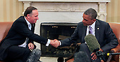 United States President Barack Obama, right, shakes hands with Prime Minister John Key of New Zealand in the Oval Office of the White House in Washington, D.C. on June 20, 2014. <br /> Credit: Dennis Brack / Pool via CNP