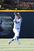 Brett Stephens (9) of the UCLA Bruins catches a fly ball during a game against the Texas Longhorns at Jackie Robinson Stadium on March 12, 2016 in Los Angeles, California. UCLA defeated Texas, 5-4. (Larry Goren/Four Seam Images)