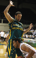 Tall Blacks forward Mika Vukona is blocked by Adam Gibson during the International basketball match between the NZ Tall Blacks and Australian Boomers at TSB Bank Arena, Wellington, New Zealand on 25 August 2009. Photo: Dave Lintott / lintottphoto.co.nz