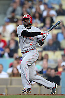 Cincinnati Reds shortstop Brandon Phillips #4 bats against the Los Angeles Dodgers at Dodger Stadium on June 14, 2011 in Los Angeles,California. (Larry Goren/Four Seam Images)