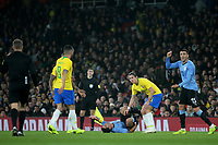 Luis Suarez of Uruguay holds his leg after a tackle from Brazil's Filipe Luis who anxiously looks at the referee  during Brazil vs Uruguay, International Friendly Match Football at the Emirates Stadium on 16th November 2018