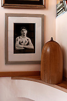 wooden sculpture and black and white picture