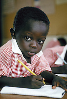 A five-year-old boy practices his writing and math skills during his preschool morning class at All Saints Cathedral in Kampala, Uganda, Africa. Kampala, Uganda Africa.