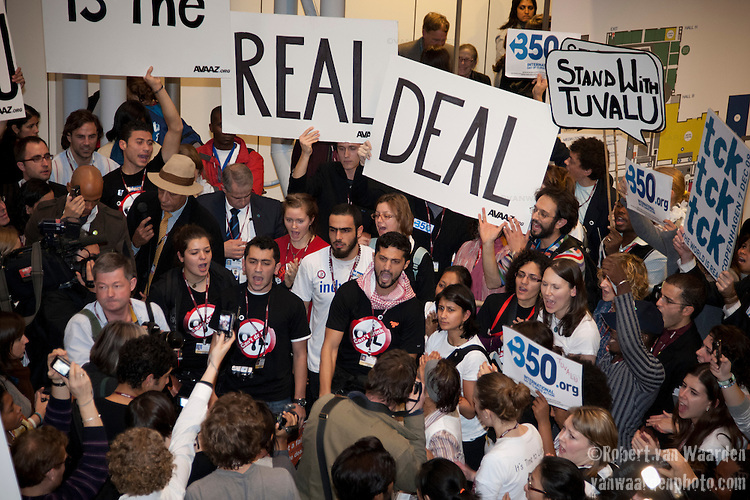 Hundreds of individuals spontaneously gathered outside the main plenary today to support Tuvalu and call for a real, fair binding deal. United Nations Climate Talks Copenhagen. (Images free for Editorial Web usage for Fresh Air Participants during COP 15. Credit: Robert vanWaarden)