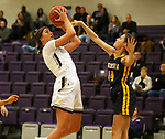 SIOUX FALLS, SD - DECEMBER 7: Anna Goodhope #2 from the University of Sioux Falls shoots against Lexi Lee #14 from Concordia St. Paul during their game Friday night at the Stewart Center in Sioux Falls, SD. (Photo by Dave Eggen/Inertia)