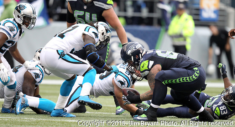 Seattle Seahawks  guard J.R. Sweezy and guard Justin Britt (64) recovered the ball fumbled by wide receiver Richardo Lockette (83) after he was tackled by  Carolina Panthers linebacker Luke Kuechly (59) at CenturyLink Field in Seattle on October 18, 2015. The Panthers came from behind with 32 seconds remaining in the 4th Quarter to beat the Seahawks 27-23.  ©2015 Jim Bryant Photography. All Rights Reserved.