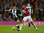 Isaac Hayden of Newcastle United tackled by Wesley of Aston Villa during the Premier League match at Villa Park, Birmingham. Picture date: 25th November 2019. Picture credit should read: Darren Staples/Sportimage