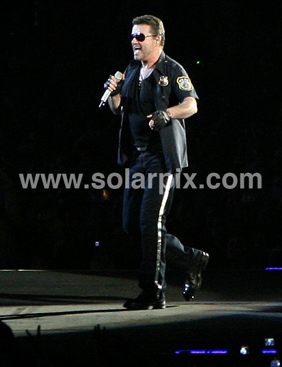 **ALL ROUND PICTURES FROM SOLARPIX.COM**.**WORLDWIDE SYNDICATION RIGHTS**.The two-time Grammy Award winning star George Michael entertains thousands of fans during his concert in at the Zayed Sports Stadium, Abu Dhabi. It's the biggest concert the country has ever seen, and it is also rumoured it is his last ever concert, Abu Dhabi, UAE. 2nd December 2008..This pic: George Michael..JOB REF: 8289 DBL     DATE: 02_12_2009.**MUST CREDIT SOLARPIX.COM OR DOUBLE FEE WILL BE CHARGED* *ONLINE USAGE FEE £50.00 PER PICTURE - NOTIFICATION OF USAGE TO PHOTO@SOLARPIX.COM*