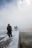 USA, Wyoming, Yellowstone National Park, a tourist passes the Grand Prismatic Spring on the Excelsior Geyser Crater Loop