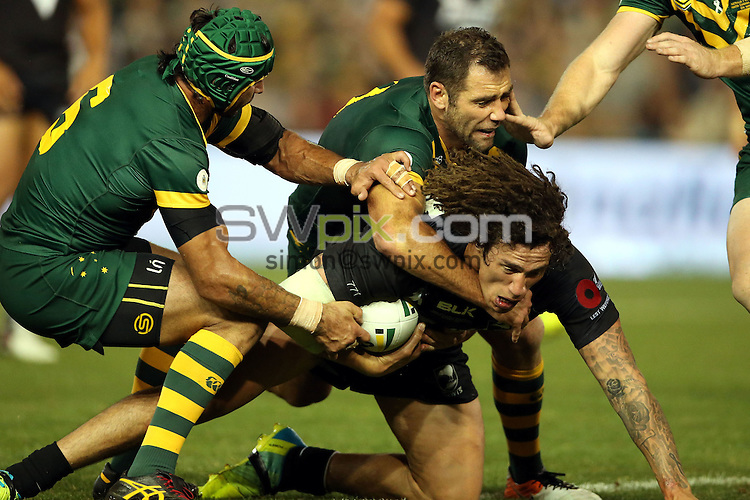 Kevin Proctor tackled by Cameron Smith<br /> Trans Tasman NZRL Kiwis v Australia Test Match at Hunter Stadium, Newcastle, Australia. Friday 6 May 2016. Photo: Paul Seiser / www.photosport.nz / SWpix.com