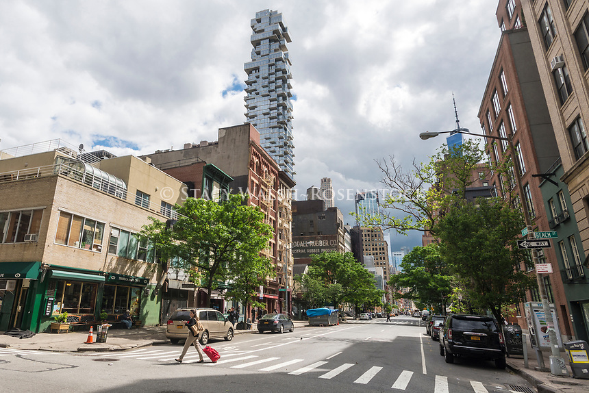 New York, USA 26 May 2017 - Empty streets in TriBeCa on a Friday before the Memorial Day Weekend as New Yorkers leave for a three day holiday. The 60 story condo, 54 Leonard Streed, known as the Jenga Building, rises above loft and industrial buildings ©Stacy Walsh Rosenstock