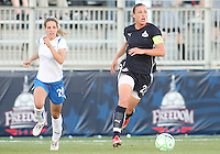 Abby Wambach #20 of the Washington Freedom pulls away from Sue Weber #20 of the Boston Breakers during a WPS match at the Maryland Soccerplex, in Boyd's, Maryland, on April 18 2009. Breakers won the match 3-1.