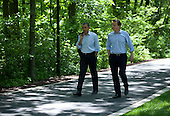 United States President Barack Obama and Prime Minister David Cameron of the United Kingdom talk as they walk from Aspen Cabin to Laurel Cabin during the G8 Summit at Camp David, Md., May 19, 2012. .Mandatory Credit: Pete Souza - White House via CNP