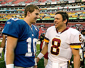 Landover, MD - December 24, 2005 -- New York Giant quarterback Eli Manning (10), left, and Washington Redskin quarterback Mark Brunell (8) meet on the field following their game against one another at FedEx Field in Landover, MD on December 24, 2005.  The Redskins won the game 35 - 20..Credit: Ron Sachs / CNP.(RESTRICTION: NO New York or New Jersey Newspapers or newspapers within a 75 mile radius of New York City)