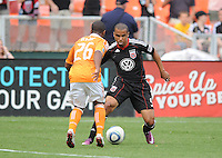 DC United forward Charlie Davies (9) goes against Houston Dynamo defender Corey Ashe  (26)   Houston Dynamo tied DC United 2-2, at RFK Stadium, Saturday June 25, 2011.