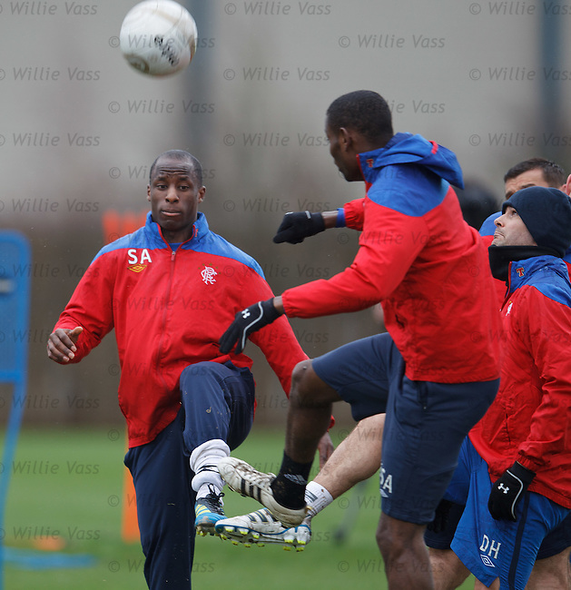 Sone Aluko and David healy go for a ball as Mo Edu charges in