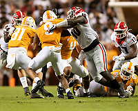 KNOXVILLE, TN - OCTOBER 5: Malik Herring #10 of the Georgia Bulldogs tackles Tyler Byrd #10 of the Tennessee Volunteers for a loss during a game between University of Georgia Bulldogs and University of Tennessee Volunteers at Neyland Stadium on October 5, 2019 in Knoxville, Tennessee.