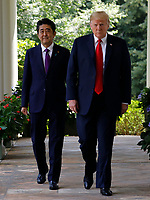 United States President Donald J. Trump and Prime Minister of Japan Shinzo Abe walk out from the Oval Office before their joint news conference in the Rose Garden of the White House on June 7, 2018 in Washington, DC. <br /> CAP/MPI/RS<br /> &copy;RS/MPI/Capital Pictures