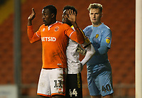 Blackpool's Joe Dodoo jostles for position with Burton Albion's Devante Cole and goalkeeper Bradley Collins<br /> <br /> Photographer Stephen White/CameraSport<br /> <br /> The EFL Sky Bet League One - Blackpool v Burton Albion - Saturday 24th November 2018 - Bloomfield Road - Blackpool<br /> <br /> World Copyright © 2018 CameraSport. All rights reserved. 43 Linden Ave. Countesthorpe. Leicester. England. LE8 5PG - Tel: +44 (0) 116 277 4147 - admin@camerasport.com - www.camerasport.com<br /> <br /> Photographer Stephen White/CameraSport<br /> <br /> The EFL Sky Bet League One - Blackpool v Burton Albion - Saturday 24th November 2018 - Bloomfield Road - Blackpool<br /> <br /> World Copyright © 2018 CameraSport. All rights reserved. 43 Linden Ave. Countesthorpe. Leicester. England. LE8 5PG - Tel: +44 (0) 116 277 4147 - admin@camerasport.com - www.camerasport.com