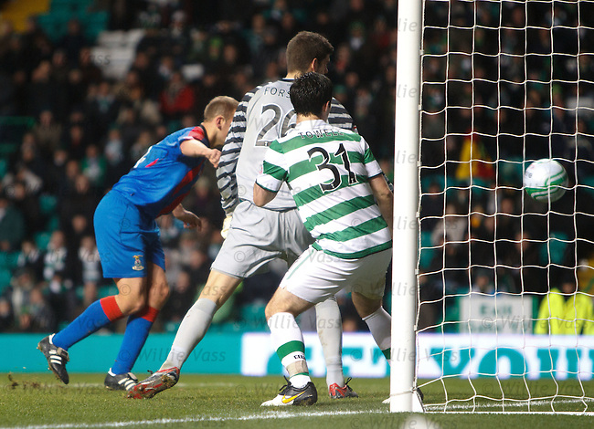 Grant Munro heads the ball into the net past Foster and Towell for Inverness' second goal