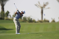 Brett Rumford (AUS) plays his 2nd shot on the 14th hole during Friday's Round 3 of the Commercial Bank Qatar Masters 2013 at Doha Golf Club, Doha, Qatar 25th January 2013 .Photo Eoin Clarke/www.golffile.ie